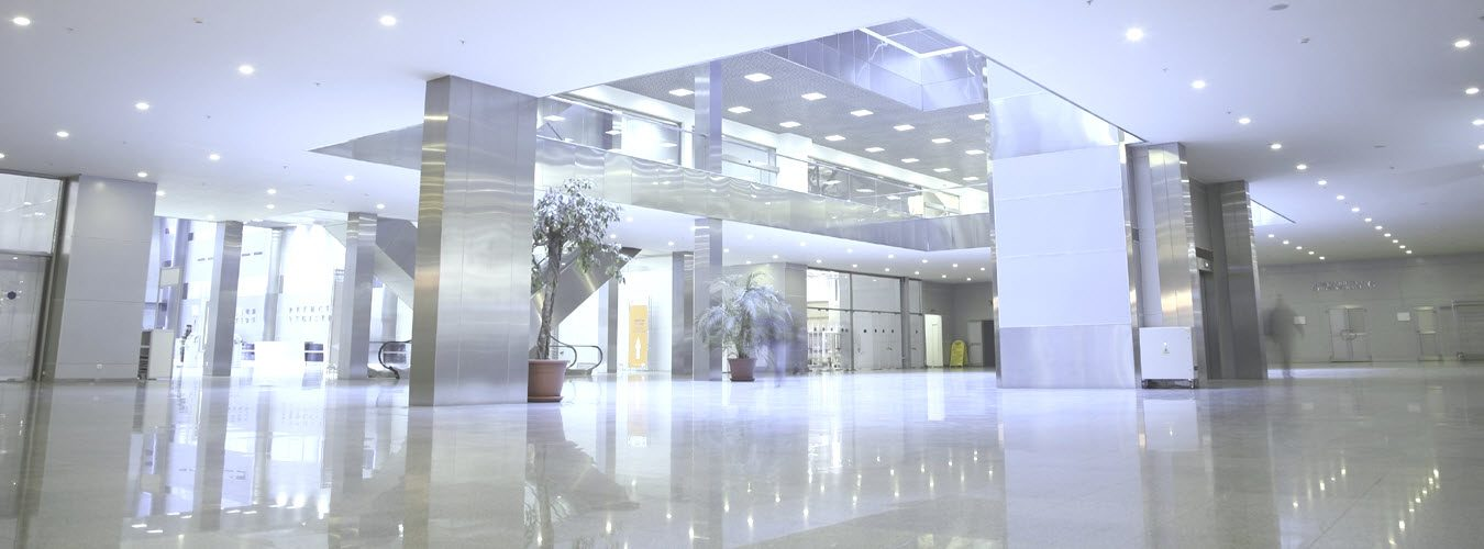 Bright corporate office building entrance with clean and shiny lobby floors